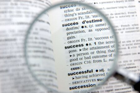 emphasized: Definition of success emphasized by a magnifying glass
