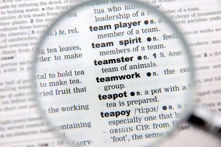 emphasized: Definition of teamwork emphasized by a magnifying glass