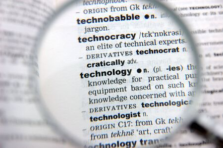 emphasized: Definition of technology emphasized by a magnifying glass Stock Photo
