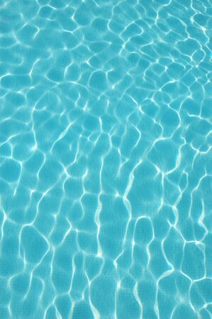 Blue water wave pattern of a swimming pool (horizontal) Stock Photo - 596714