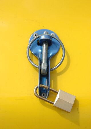 Security lock against yellow background Stock Photo - 598326