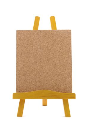 Corkboard with wooden stand in isolated white background photo