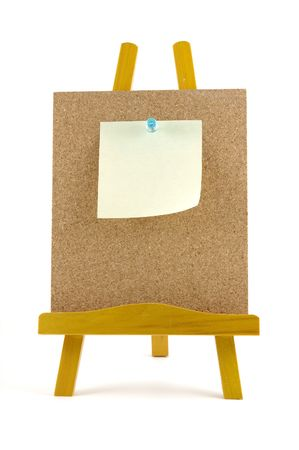 Pinned note on corkboard with wooden stand, isolated background Stock Photo - 601194