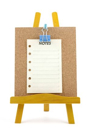 Pinned note on corkboard with wooden stand, isolated background Stock Photo - 601192