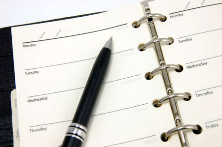 dayplanner: Opened organizer and pen