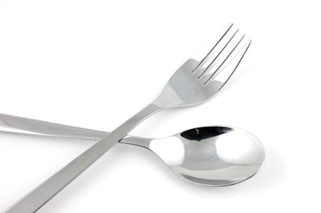 Fork and spoon in isolated white background photo