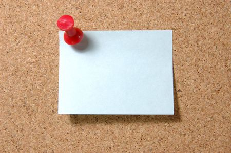 Blue post-it note with red pushpin on corkboard Stock Photo - 601058
