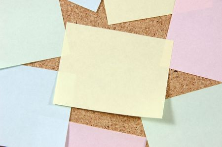 Close up of colorful post-it notes on corkboard photo