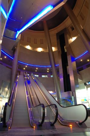 Interior of a modern mall with escalator