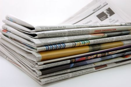 Pile of newspaper in isolated background Stock Photo - 600970