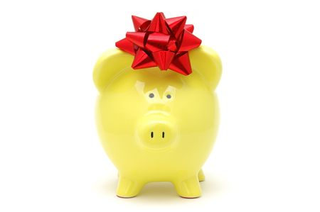 Yellow piggy bank with a red bow on his head, isolated white photo