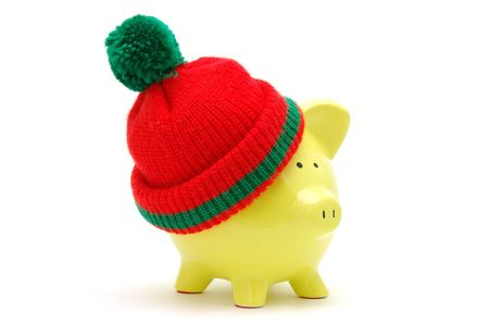 christmas profits: Yellow piggy bank with christmas hat in isolated white Stock Photo