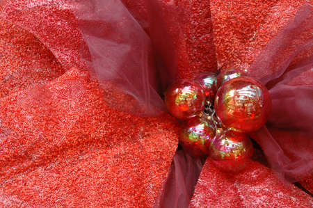 Christmas ornaments in red poinsettia background photo