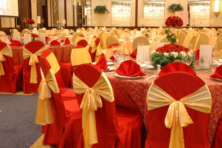 Table setting and decoration in a wedding banquet photo