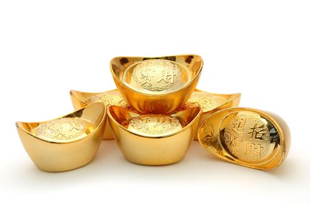Decoration of chinese gold ingots in isolated white background photo