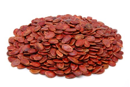 chinese new year food: Red melon seed in isolated white background