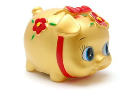 Ms piggy bank in golden color, isolated white photo