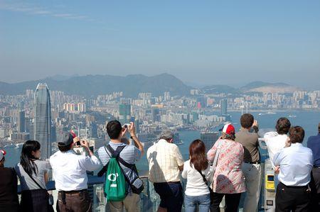 Touristen Sehenswürdigkeiten der Skyline von Hong Kong auf dem Höhepunkt