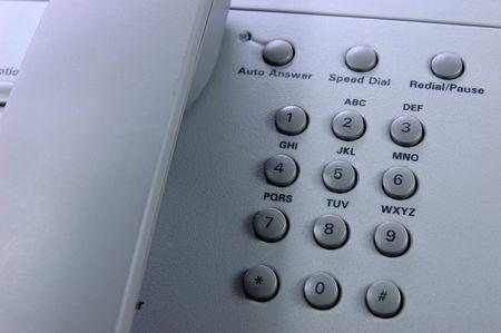 teclado num�rico: Tel�fono cerca de la ca�er�a y teclado num�rico Foto de archivo