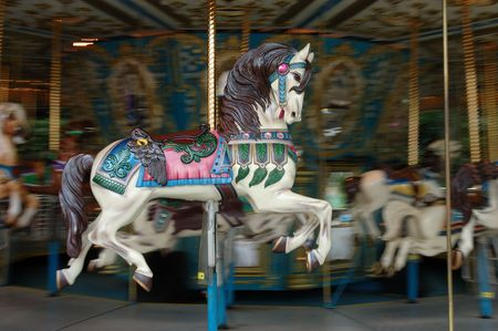Carousel horse on a moving merry go round Stock Photo