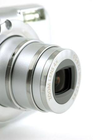taking video: Close up of a compact digital camera zoom lens