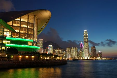 Sunset scene of Hong Kong Convention and Exhibition Centre and cityscape photo