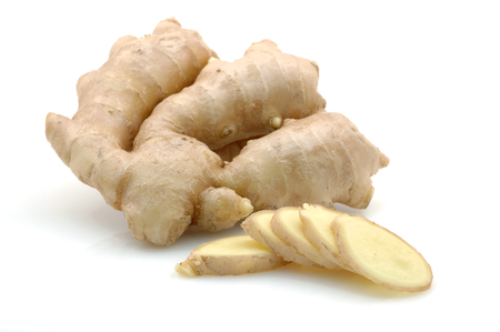 Whole and sliced ginger root in isolated white background Stock Photo
