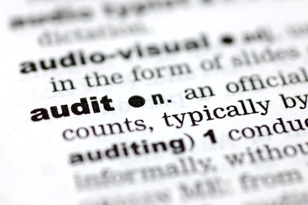 define: A close up of the word audit from a dictionary Stock Photo