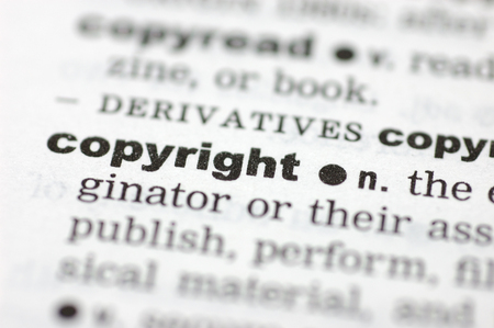 definition define: A close up of the word copyright from a dictionary