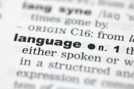 definition define: A close up of the word language from a dictionary Stock Photo