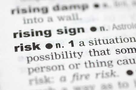 definition define: A close up of the word risk from a dictionary