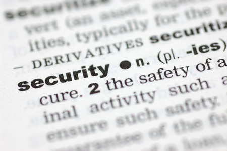 definition define: A close up of the word security from a dictionary