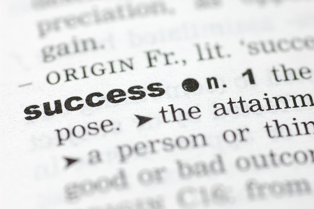 definition define: A close up of the word success from a dictionary Stock Photo