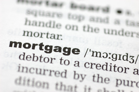 definition define: A close up of the word mortgage from a dictionary Stock Photo