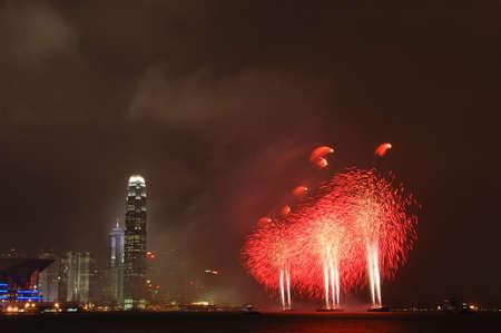 Red fireworks and Hong Kong skyline night scene photo