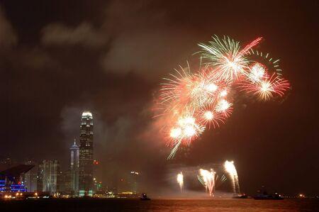 Fireworks and Hong Kong skyline night scene photo
