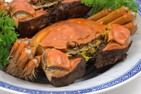 Closeup of steamed shanghai crabs on plate