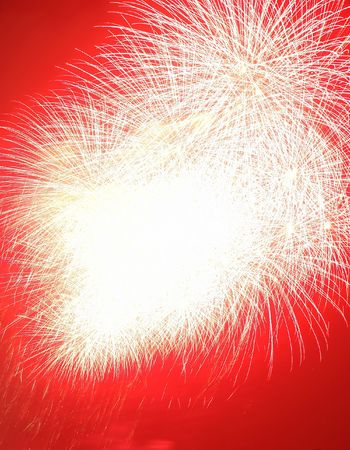 Abstract fireworks explosion in red photo