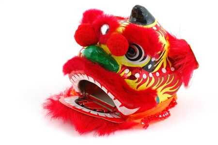 Chinese dancing lion head decoration in isolated white background
