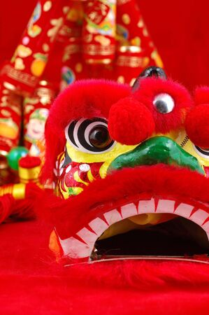 Close up of chinese lion head decoration over red background Stock Photo
