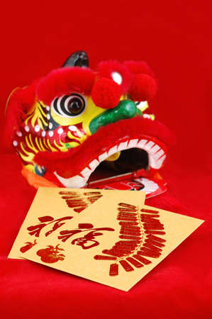 Red packets and chinese lion head decoration over red background photo