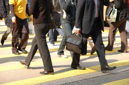 A crowd of pedestrians crossing street in the city Stock Photo