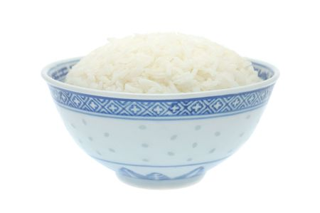 Bowl of cooked rice in isolated white background Stock Photo