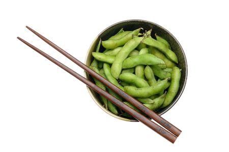 Bowl of edamame with chopsticks isolated on white photo