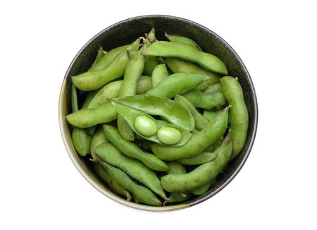 Bowl of edamame (green soybean) in isolated white background photo
