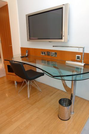 Work desk with plasma TV in a modern hotel room photo