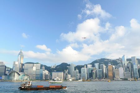 Hong Kong skyline with cargo container, ferry and helicopter photo