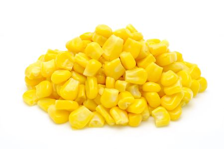 corn kernel: Stack of sweetcorn kernels in isolated white background