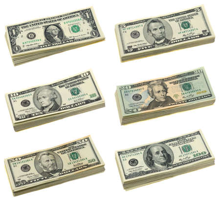 Stacks of US dollar bills in isolated white background photo