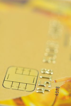 Close up of golden credit card with chip photo